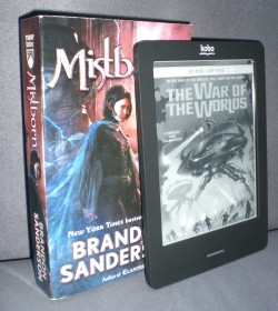 Kobo Touch next to a standard US mass paperback